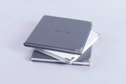 lay flat professionally printed Photo Album with hardcover nphoto professional photographer printing labs professional printing services classic metal corners uai